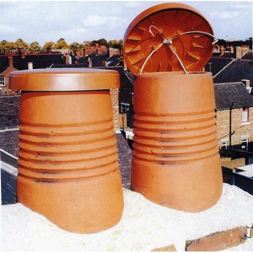 Terracotta Chimney Cap on chimney pot ontop of house - chimney sheep
