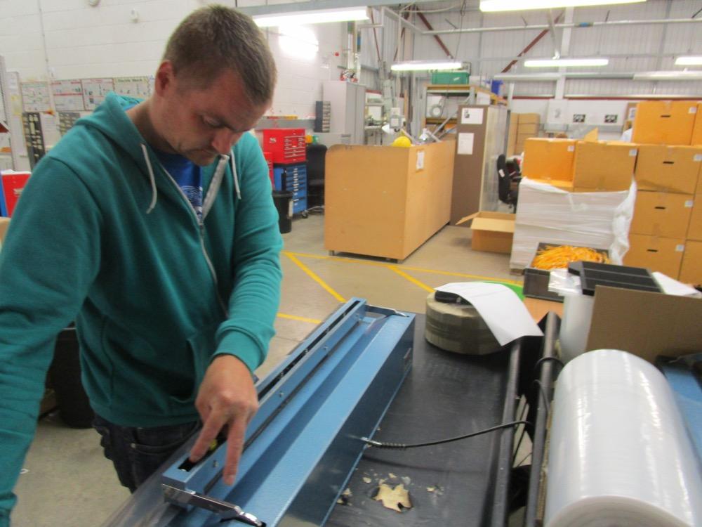 worker at Watford Workshop constructing chimney balloons