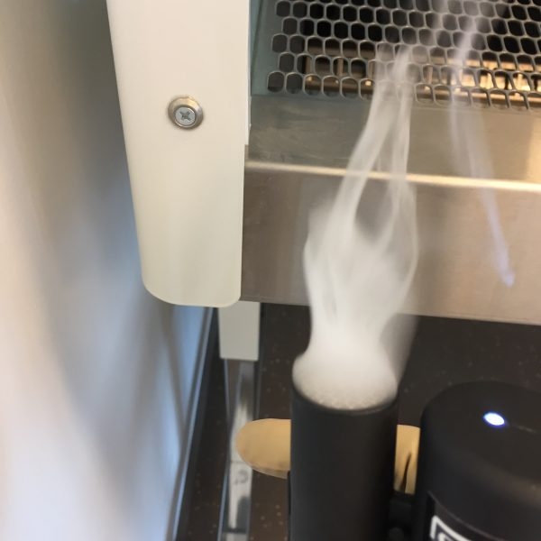 Smoke pencil draught detector testing for air tightness in hospital laboratory