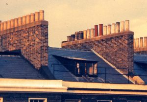 rows of multiple chimney pots on roofs showing how many open chimneys there are in many properties and how many chimney balloons are required to block out wind noise